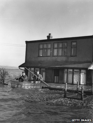 Residents using a rowing boat to leave their homes in 1953 (Getty Images)