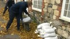 Residents put sandbags outside their homes in Sandwich, Kent