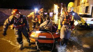 Rescuers taking people to safety in a boat in Boston, Lincs
