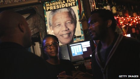 Patrons gather at the Madiba South African restaurant following the announcement of the death of former South African President Nelson Mandela  in the Brooklyn borough of New York, United States 5 December 2013