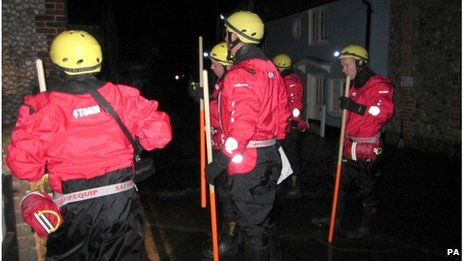 Firefighters carried out house-to-house checks in Blakeney, Norfolk, overnight