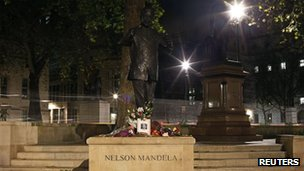 Flowers at Mandela statue in London (6 Dec 2013)