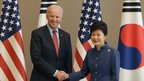 US Vice President Joe Biden (L) shakes hands with South Korean President Park Geun-Hye (R) during their meeting in Seoul on 6 December 2013