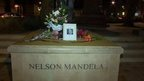 Flowers on Nelson Mandela statue