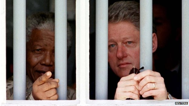 Nelson Mandela and Bill Clinton visit the former South African president's cell on Robben Island in 1998