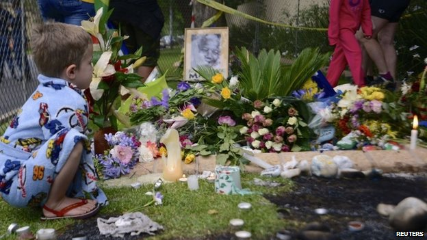 Young white boy pays tribute outside Mr Mandela's house in Johannesburg
