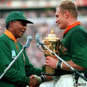 Nelson Mandela presents the rugby World Cup to Springbok captain Francois Pienaar in 1995