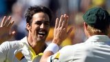 Australian paceman Mitchell Johnson (2nd R) celebrates the wicket of England's Alastair Cook