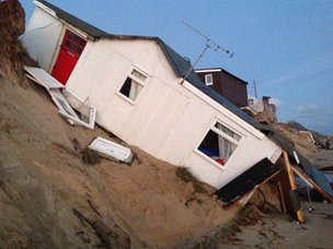 House has slid down cliff