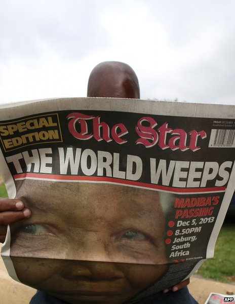 A man reads The Star in Soweto, South Africa, 6 December