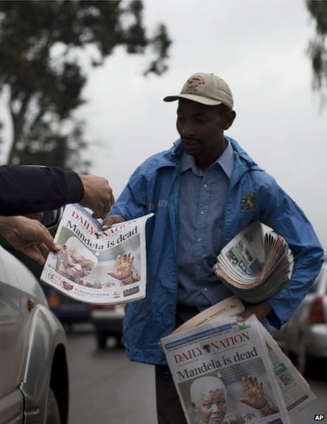 A newspaper vendor in Nairobi, Kenya, 6 December