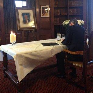 David Cameron signing condolence book