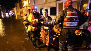 Woman is rescued during floods in Boston