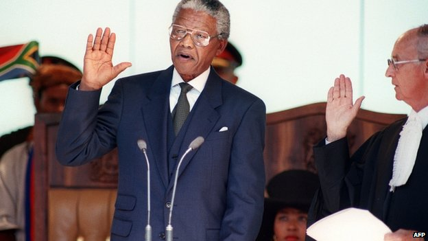 Nelson Mandela takes his oath on 10 May 1994 during his inauguration as president at the Union Building in Pretoria, South Africa