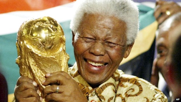 Former South African President Nelson Mandela lifts the World Cup trophy in Zurich, Switzerland, on 15 May 2004 after Fifa's executive committee announced that South Africa would host the 2010 World Cup
