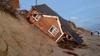 Beach chalets collapsed in Norfolk.