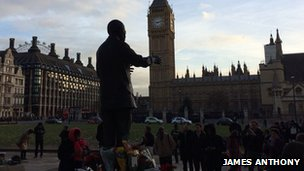 People gathered around the Mandela statue in Parliament Square
