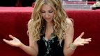 Mexican singer-songwriter Thalia looks at her star after it was unveiled on the Hollywood Walk of Fame
