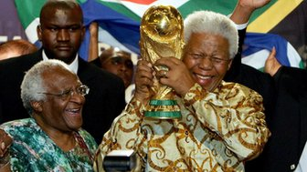 Nelson Mandela holds the Jules Rimet World cup beside Capetown Archbishop Desmond Tutu