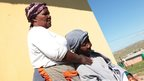 Family members Nowam Mandela and Nontsikelelo Mandela mourn in Nelson Mandela's home village of Qunu