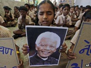 schoolgirl  holding a portrait of Mr Mandela