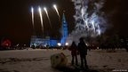 Children watch fireworks during a Christmas light illumination ceremony on Parliament Hill in Ottawa