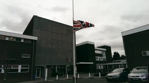 Flag flying at half mast at The Coopers' Company and Coborn School in Upminster