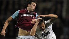 Andy Carroll jumps for the ball