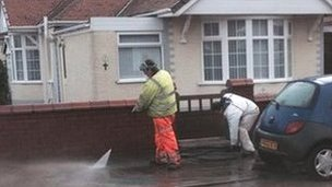Rhyl flood clean-up scene