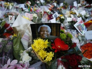 Flowers and tributes are left for Nelson Mandela at South Africa's High Commission in London
