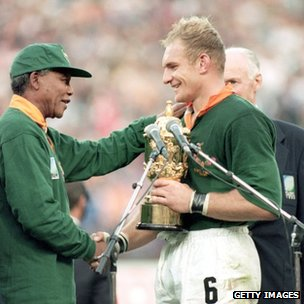 Francois Pienaar of South Africa receives the William Webb Ellis Trophy from President Nelson Mandela after the Rugby World Cup final between South Africa and New Zealand, held on 24 June 1995 at Ellis Park in Johannesburg, South Africa.