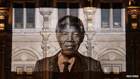 An image of late South African President Nelson Mandela is projected on the facade of Paris town hall 6 December 2013