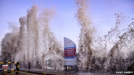 Picture taken at the seafront in Cleethorpes as waves hit (smash against) the seafront during stormy weather