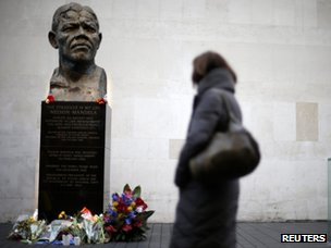 A woman looks at a statue of South Africa's former president Nelson Mandela at South Bank in London