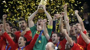 Spain team members celebrate with the World Cup trophy after the World Cup final soccer match between the Netherlands