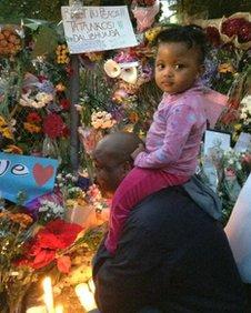 ZiggyMaqabe & 2 year-old Oratile laying wreaths