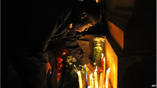 A man lights a candle outside the Union Buildings in Pretoria