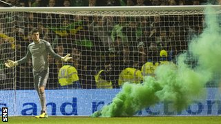 A flare lands close to Fraser Forster