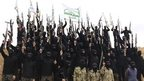 Islamist fighters dressed in black with rifles. File photo