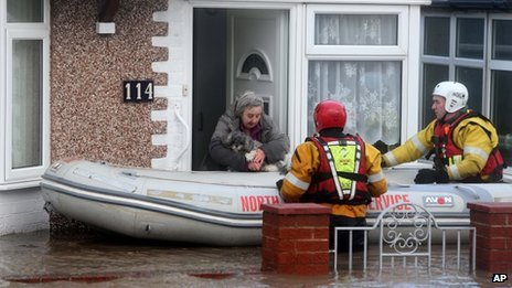 Woman and her dog are rescued by the Royal National Lifeboat Institute,  in Rhyl, Denbighshire, on Thursday