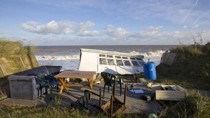 Belongings left on cliff as holiday chalet falls