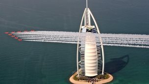 Red Arrows flying past the Burj Al Arab hotel in Dubai