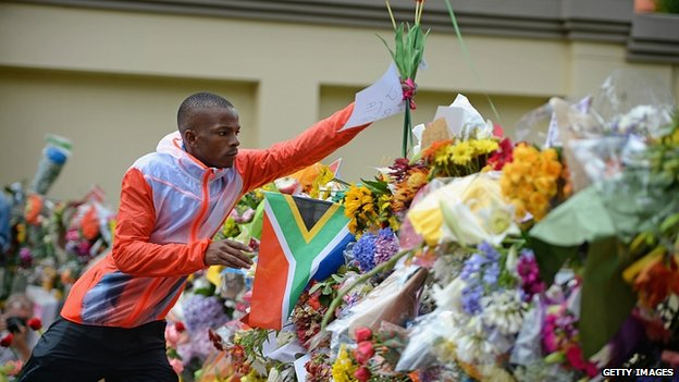 Flowers piled up outside Mandela's home in Houghton. 7 Dec 2013