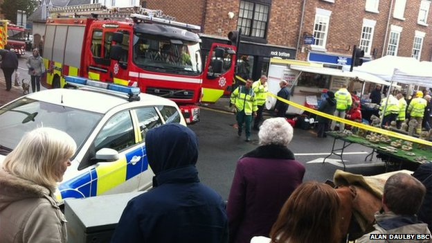 Eight hurt as car hits market stalls...