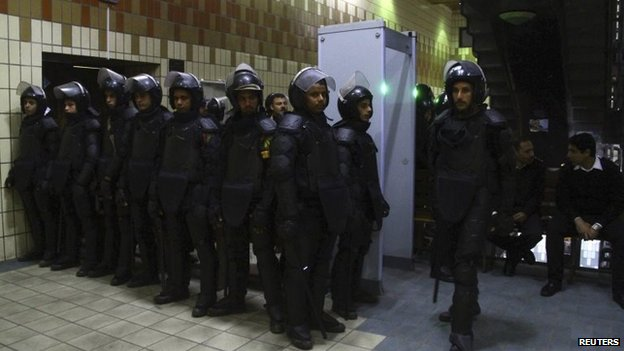 Riot police stand outside the courthouse