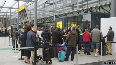 Passengers queue outside Terminal 3 at Heathrow Airport in west London