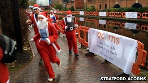 Men and women taking part in a Santa Run in Birmingham
