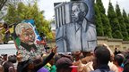 Portraits of Nelson Mandela held up in Houghton