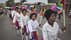 Children march up Vilakazi Street in Soweto (7 Dec)