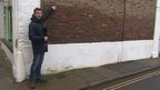 BBC reporter Ed Thomas points out how high the tidal surges were in Boston, Lincolnshire